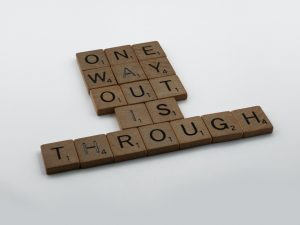 Image contains this saying: one way out is through.
